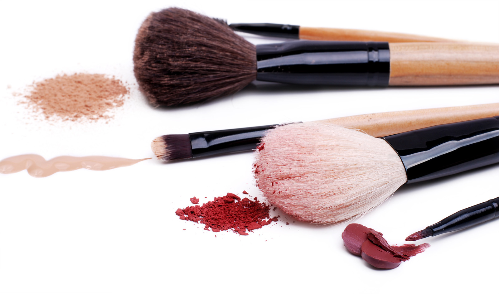 Set of makeup professional brushes with sample cosmetics